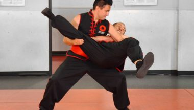 Image of Donald Tittle, a Combat Kung-Fu Instructor & 6th Generation Choy Li Fut Master, Applying a Take-Down Technique