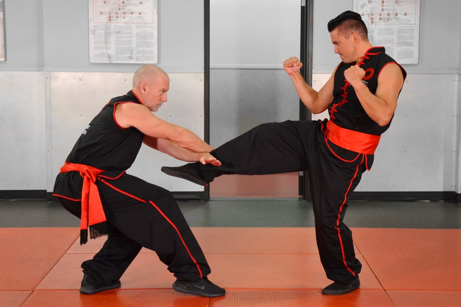 Master Nathan Fisher, Founder of Combat Kung-Fu, Shows How to Block and Take Control of an Attacker's Kicking Leg