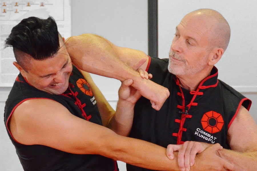 Image of Master Nathan Fisher, Founder of Combat Kung-Fu & 5th Generation Choy Li Fut Master, Showing How to Disable an Attacker with a Close-In Self-Defense Technique