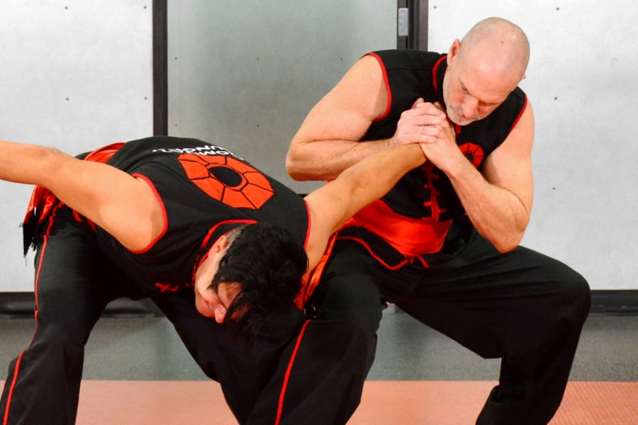 Master Nathan Fisher, Founder of Combat Kung-Fu, shows how to use a wrist lock for self-defense.