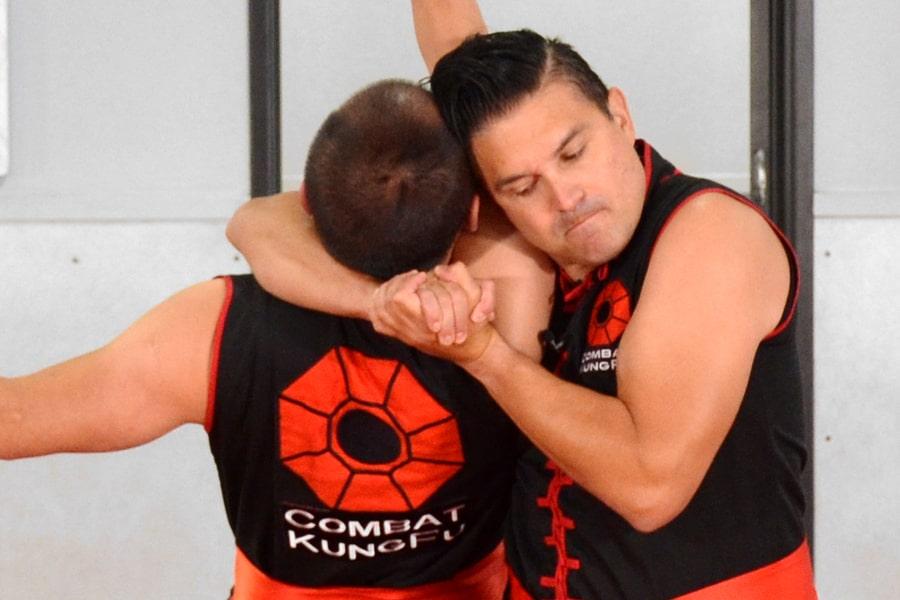 Image of Tai Sifu Donald Tittle, a Combat Kung-Fu contributor, applying a carotid choke to incapacitate an attacker.