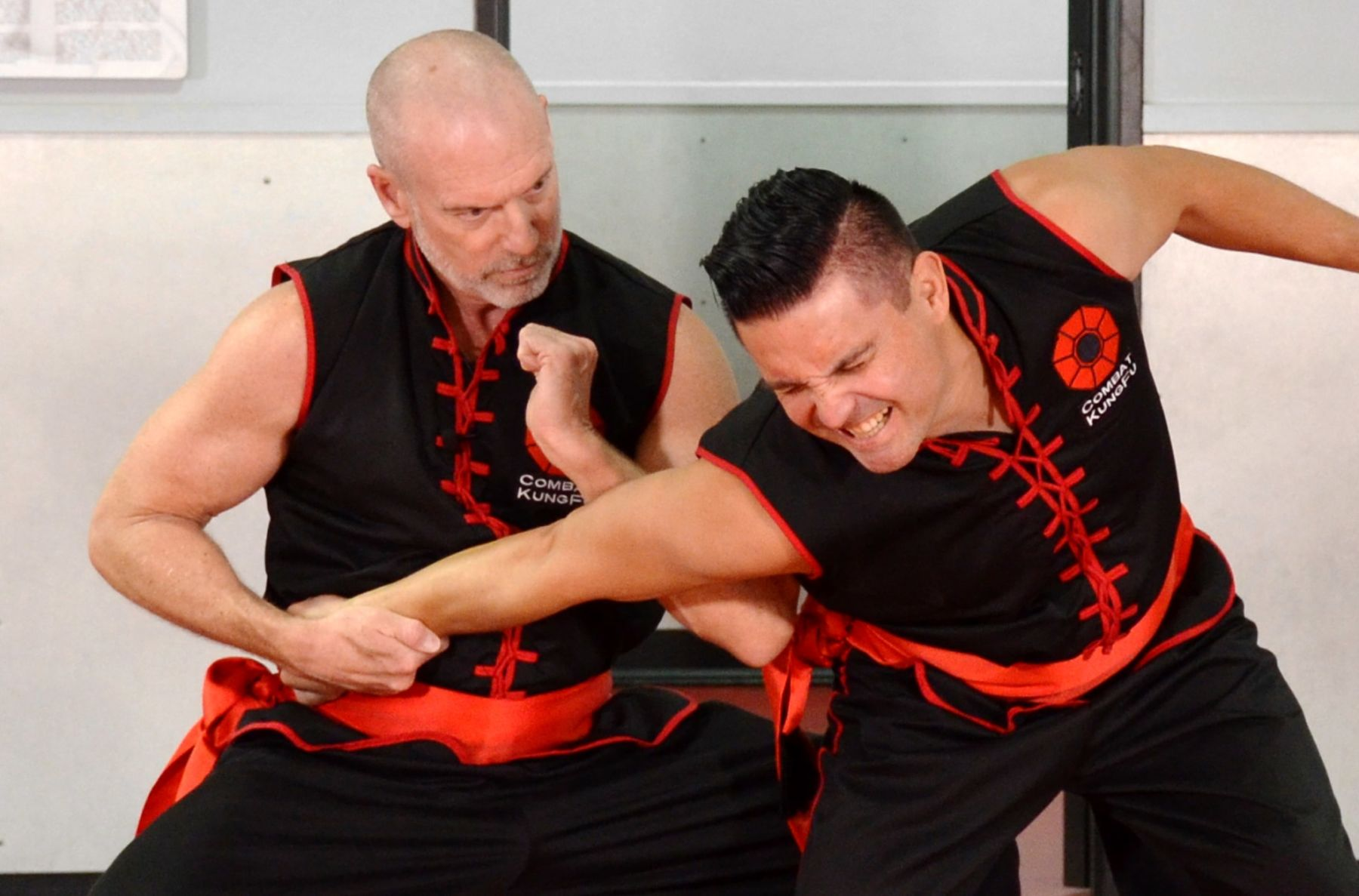 Image of Master Fisher, Founder of Combat Kung-Fu, performing an elbow dislocating technique, one of Choy Li Fut Kung-Fu's very effective close-in fighting moves.