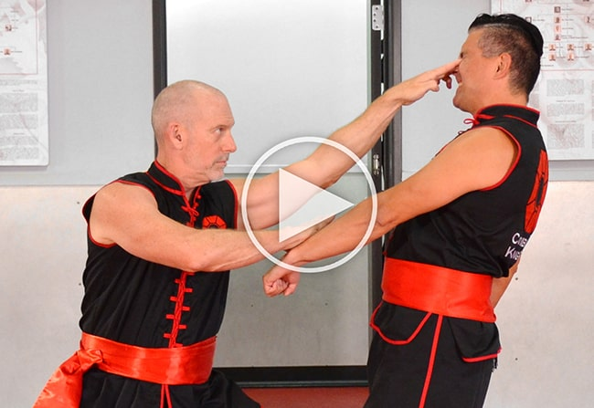 Master Fisher, Founder of Combat Kung-Fu, performs a blinding technique for self-defense.