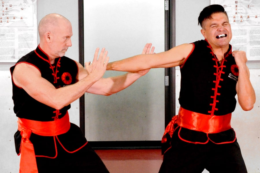 Master Nathan Fisher, the Founder of Combat Kung-Fu, stops a punch attack by dislocating the attacker's arm.