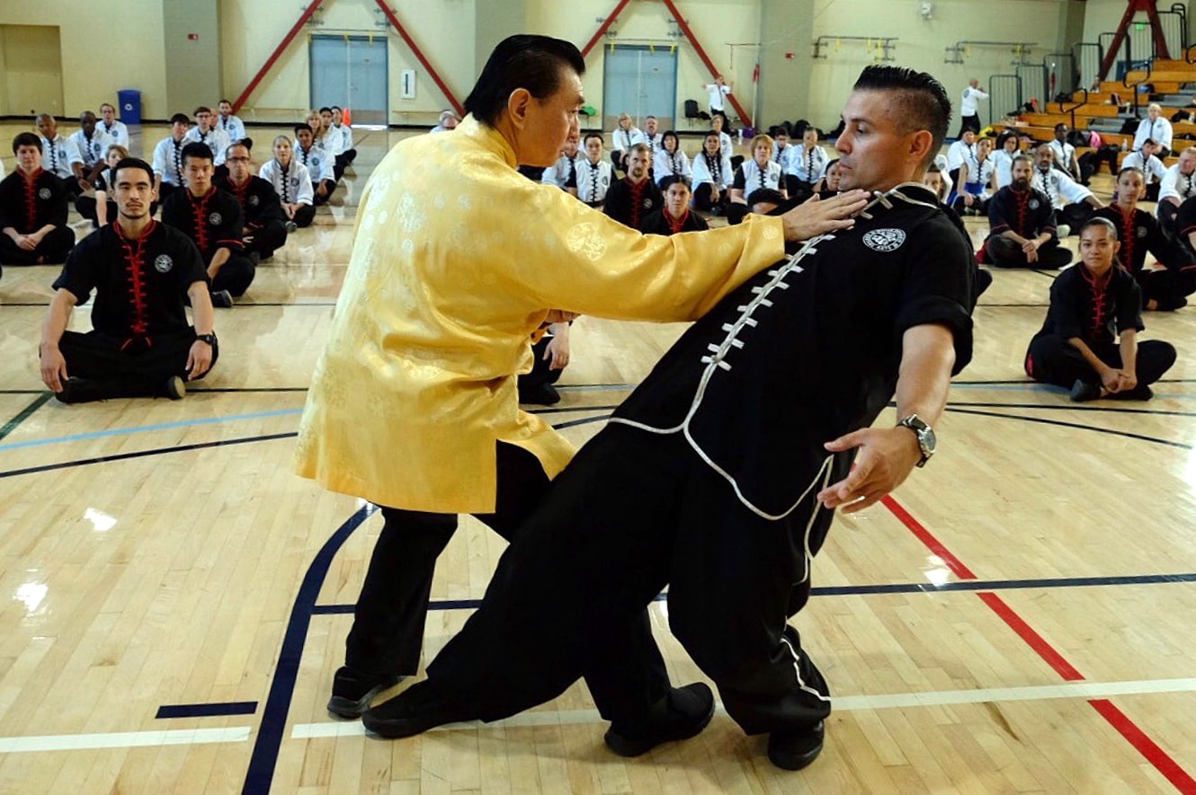 Grandmaster Doc-Fai Wong, a fourth generation Choy Li Fut Grandmaster, shows a tripping move